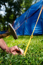 Fixing of blue tent in camp Stock Photography