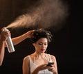 Fixing curls hairdresser using hairspray to fix of beautiful vietnamese woman Stock Photos