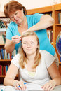 Fixing Daughter\'s Hair Royalty Free Stock Photo