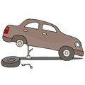 Fixing flat tire an image of a Royalty Free Stock Photos