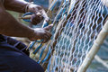 Fixing the net a fishman fixes his fishing off coast of phuket thailand Stock Photography