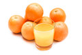 Fizzy orange juice from effervescent tablet with oranges at backdrop Stock Image