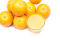 Fizzy orange juice from effervescent tablet with oranges at backdrop Royalty Free Stock Image