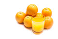 Fizzy orange juice from effervescent tablet with oranges at backdrop flushed right Royalty Free Stock Photos