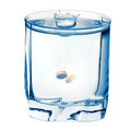 Fizzy pill in the glass of water isolated on a white background with clipping path Stock Images