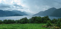 Fjord in a hazy weather norway with dramatic overcast sky panorama Royalty Free Stock Photography