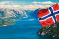 Fjord in Norway with flag Royalty Free Stock Photo