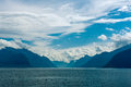 Fjord scene with hazy mountains and cloudy sky norway in a overcast day Royalty Free Stock Photo