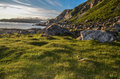 Fjords of norway sunset on a patch grass Stock Photo