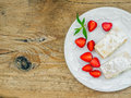 Flacky pastry on a wooden desk with cream and fresh strawberry background Royalty Free Stock Photography