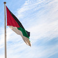 Flag of the Arab Revolt with blue sky in Aqaba Royalty Free Stock Photo