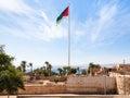 Flag of Arab Revolt over Mamluk Castle in Aqaba Royalty Free Stock Photo