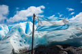 Flag of Argentina against the background of the glacier. Shevelev. Royalty Free Stock Photo