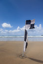 Flag on beach b w with blue sky with clouds Royalty Free Stock Photography