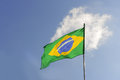 Flag of brazil brazilian waving in the sky Royalty Free Stock Photo