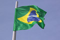 Flag of brazil over blue sky Royalty Free Stock Images