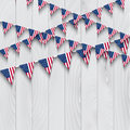 Flag bunting on wooden background american a Stock Photo