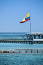 Flag of colombia over the turqoise ocean cartagena de indias south america seascape with colombian at latin culture Stock Photo