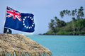 Flag of the cook islands national and jolly roger pirates wave in wind at muri lagoon in rarotonga Stock Images