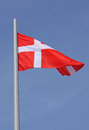 Flag of denmark over blue sky Royalty Free Stock Photography