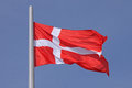 Flag of denmark over blue sky Stock Image