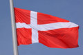 Flag of denmark over blue sky Stock Images