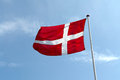 Flag of denmark up high in the air with clear blue sky background Royalty Free Stock Image