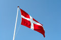 Flag of denmark up high in the air with clear blue sky background Royalty Free Stock Images