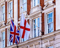Flag of England and the Union Jack on the Georgian Facade Buildi Royalty Free Stock Photo