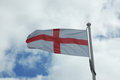 Flag of england waving in the wind Stock Images