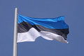 Flag of estonia over blue sky Stock Photos
