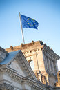 The flag of the european union on top reichstag building in berlin germany Stock Images