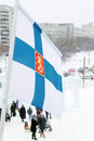 Flag of finland on wind at winter cloudy day in street city Royalty Free Stock Photos