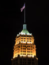 Flag Flies Above the Tower Life Building at Night Royalty Free Stock Photo