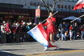 Flag girl chinese new year parade in downtown los angeles february st Royalty Free Stock Images
