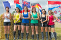 Flag girls swingfield uk august the ladies representing their country competing in the longtrack grass track world championship Royalty Free Stock Image