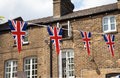 Flag of great britain with house in background union jack a typical british the Royalty Free Stock Images
