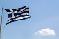 Flag of greece national over the acropolis Royalty Free Stock Image