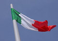 Flag of italy over blue sky Stock Photos