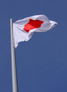 Flag of japan over blue sky Royalty Free Stock Photos