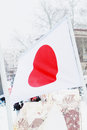 Flag of japan on wind at winter cloudy day in street city Stock Photography