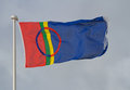 The flag of lapland region and sami people flying on a pole Stock Image