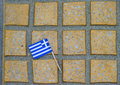 Flag mini greek on the surface of yellow mosaic tiles Stock Image