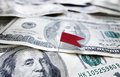 Flag money red pin stuck in a pile of cash Stock Photos