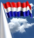 The flag of the Netherlands Dutch: Vlag van Nederland is a horizontal tricolor of red, white, and blue. The tricolor flag is jus Royalty Free Stock Photo