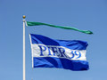 Flag of pier san francisco waving in the wind fisherman s wharf ca Stock Images