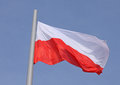 Flag of poland over bkue sky Stock Photo