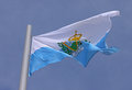 Flag of san marino over blue sky Stock Photos