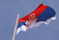 Flag of serbia over blue sky Royalty Free Stock Images