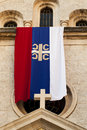 Flag serbian orthodox church being ancient church city kotor montenegro Royalty Free Stock Images